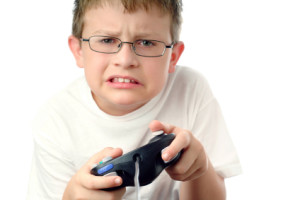 iStock_aggressive-boy-playing-video-games